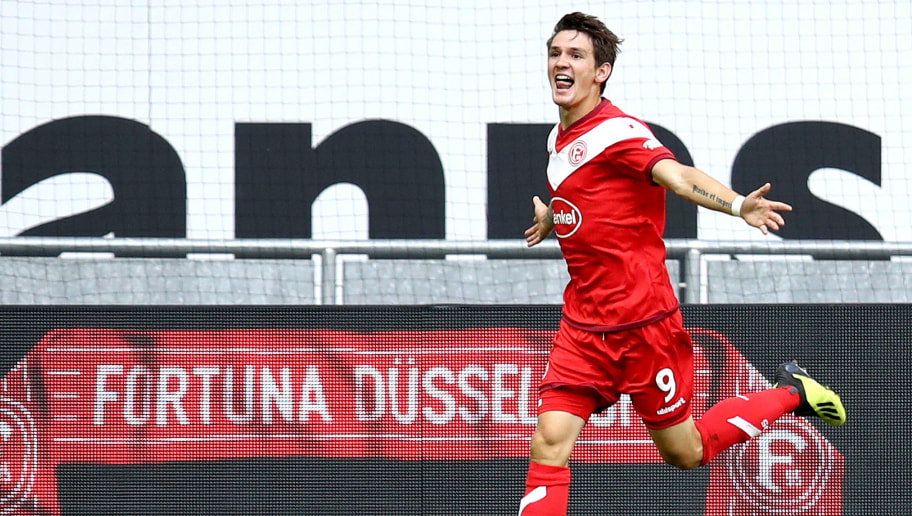 DUESSELDORF, GERMANY - AUGUST 25:  Benito Raman of Dusseldorf celebrates after scoring his team's first goal during the Bundesliga match between Fortuna Duesseldorf and FC Augsburg at Merkur Spiel-Arena on August 25, 2018 in Duesseldorf, Germany.  (Photo by Maja Hitij/Bongarts/Getty Images)
