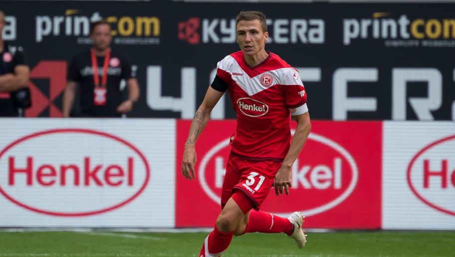 DUESSELDORF, GERMANY - AUGUST 25: Marcel Sobottka of Fortuna Duesseldorf controls the ball during the Bundesliga match between Fortuna Duesseldorf and FC Augsburg at Esprit-Arena on August 25, 2018 in Duesseldorf, Germany. (Photo by TF-Images/Getty Images)