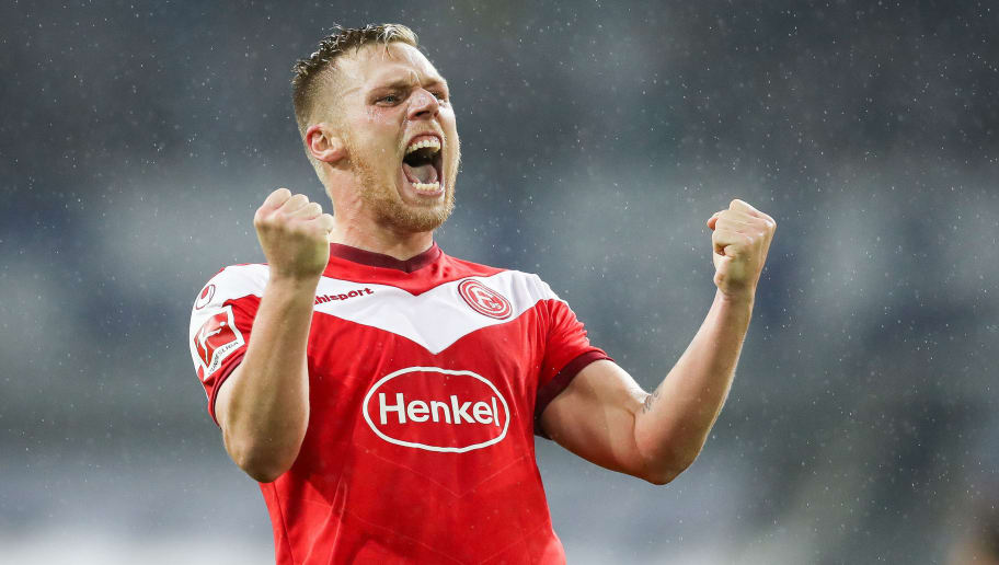 DUESSELDORF, GERMANY - NOVEMBER 10: Rouwen Hennings of Fortuna Duesseldorf celebrates after scoring his team's second goal during the Bundesliga match between Fortuna Duesseldorf and Hertha BSC at Esprit-Arena on November 10, 2018 in Duesseldorf, Germany. (Photo by Maja Hitij/Bongarts/Getty Images)