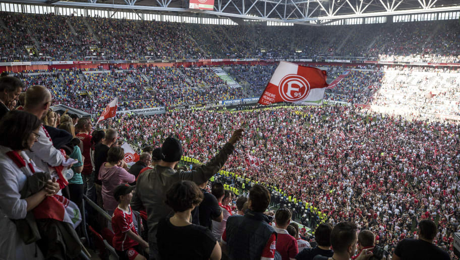 DUESSELDORF, GERMANY - MAY 06: Fans of Fortuna Duesseldorf celebrate their first league advancement after the Second Bundesliga match between Fortuna Duesseldorf and Holstein Kiel at Esprit-Arena on May 6, 2018 in Duesseldorf, Germany. (Photo by Maja Hitij/Bongarts/Getty Images)