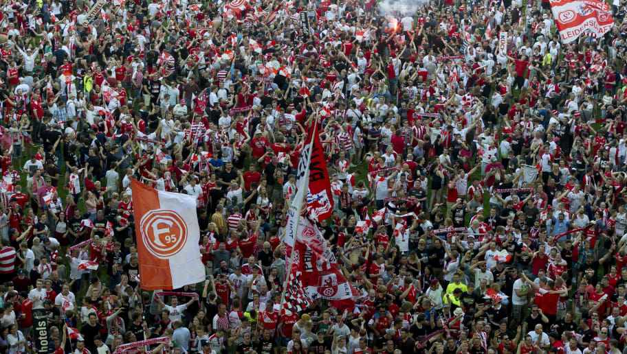DUESSELDORF, GERMANY - MAY 06: Fans of Fortuna Duesseldorf celebrate their first league advancement after the Second Bundesliga match between Fortuna Duesseldorf and Holstein Kiel at Esprit-Arena on May 6, 2018 in Duesseldorf, Germany. (Photo by TF-Images/Getty Images)