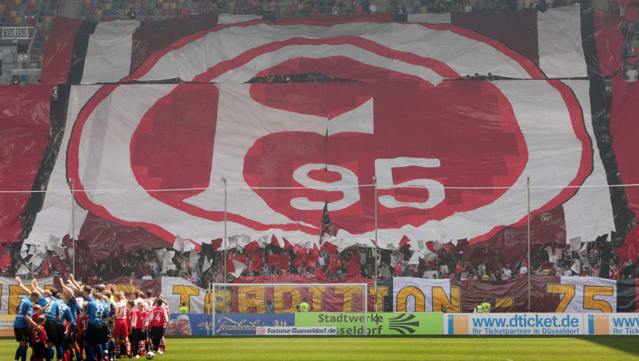 DUESSELDORF, GERMANY - JULY 27: The teams of Duesseldorf and Paderborn are seen with a banner of the Fortuna Duesseldorf logo in background ahead of the 3. Bundesliga match between Fortuna Duesseldorf and SC Paderborn at the LTU Arena on July 27, 2008 in Duesseldorf, Germany. (Photo by Thomas Starke/Bongarts/Getty Images for DFB)