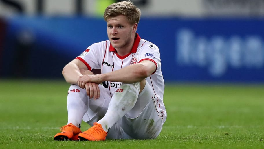 DUESSELDORF, GERMANY - APRIL 06: Jean Zimmer of Duesseldorf looks dejected after the Second Bundesliga match between Fortuna Duesseldorf and VfL Bochum 1848 at Esprit-Arena on April 6, 2018 in Duesseldorf, Germany. The match between Duesseldorf and Bochum ended 1-2. (Photo by Christof Koepsel/Bongarts/Getty Images)