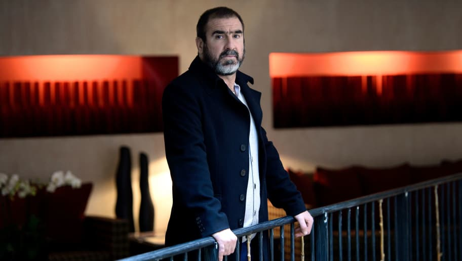 TO GO WITH AFP STORIES Former French football player turned actor Eric Cantona poses  in Paris on November 12, 2014. The award of the 2022 World Cup to Qatar was a 'mistake', declared Cantona in an interview to Agence France Presse, on November 12, 2014. AFP PHOTO / STEPHANE DE SAKUTIN / AFP PHOTO / STEPHANE DE SAKUTIN        (Photo credit should read STEPHANE DE SAKUTIN/AFP/Getty Images)