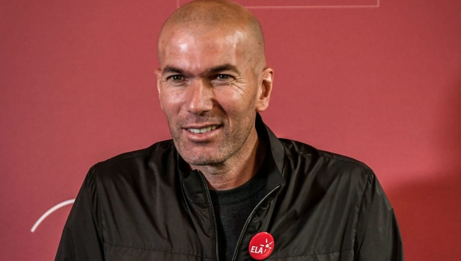 Former French football player and European Leukodystrophy Association (ELA) patron Zinedine Zidane poses with the 'Zidane's Crystal Foot' created by Baccarat on June 12, 2018 in Paris. - French crystal glass maker Baccarat has created 100 units of Zidane's Crystal Foot, worth 40,000 euros each, for the benefit of the European Association against Leukodystrophy (ELA). (Photo by STEPHANE DE SAKUTIN / AFP)        (Photo credit should read STEPHANE DE SAKUTIN/AFP/Getty Images)