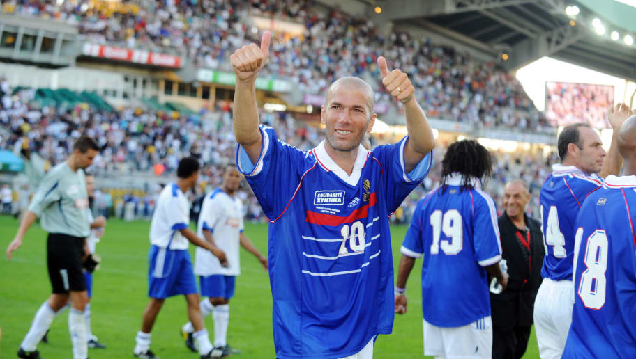 France's 98 champion and former football player Zinedine Zidane (C) waves to supporters on August 8, 2010 after winning a charity football match opposing the 1998 world champions and a European select side at La Beaujoire stadium in Nantes, western France. The match aims to raise funds for victims of severe flooding and the violent 'Xynthia' windstorms, which crossed western Europe in late February 2010 and which hit France particularly hard. AFP PHOTO FRANK PERRY (Photo credit should read FRANK PERRY/AFP/Getty Images)