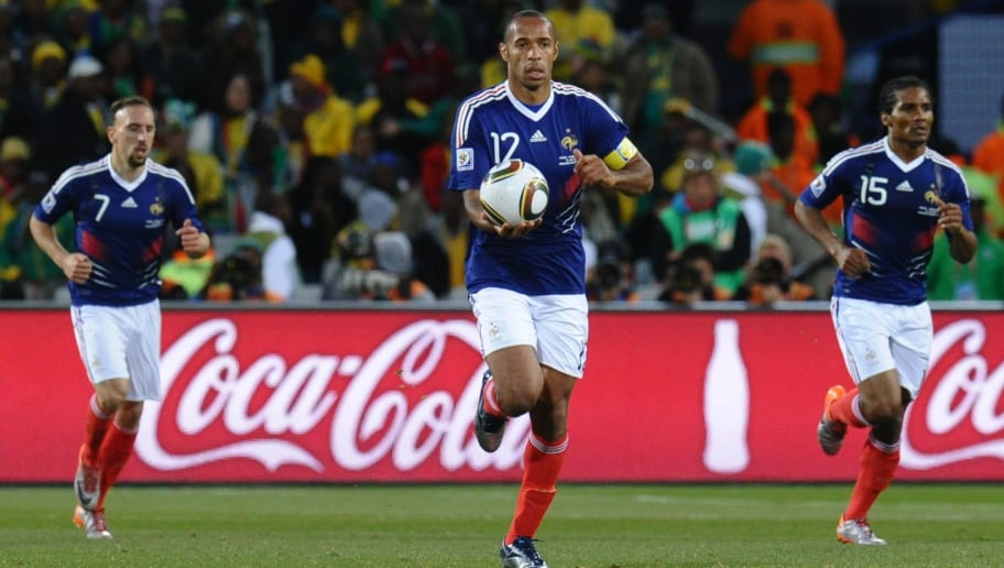 France's striker Thierry Henry (C) runs