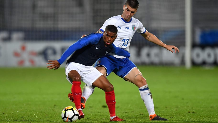 BESANCON, FRANCE - MAY 29:  Samuel Grandsir (L) of France U21 is challenged by Gianluca Mancini of Italy U21 during the International Friendly match between France U21 and Italy U21 on May 29, 2018 in Besancon, France.  (Photo by Valerio Pennicino/Getty Images)