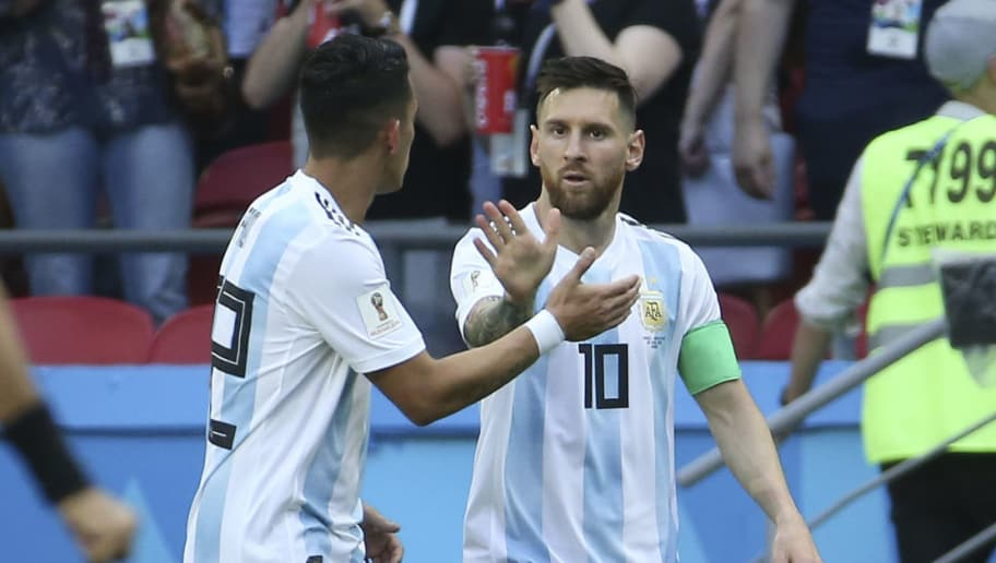 KAZAN, RUSSIA - JUNE 30: Lionel Messi celebrates a goal for Argentina with Cristian Pavon (left) during the 2018 FIFA World Cup Russia Round of 16 match between France and Argentina at Kazan Arena on June 30, 2018 in Kazan, Russia. (Photo by Jean Catuffe/Getty Images)