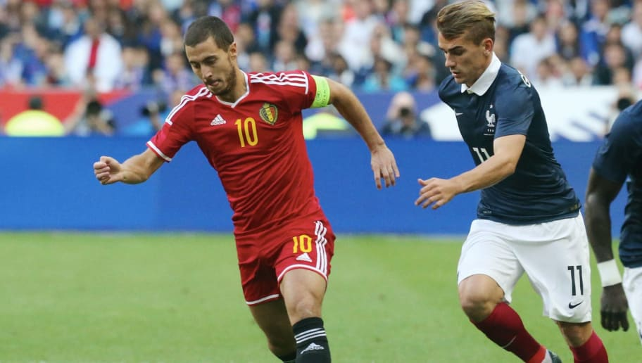PARIS, FRANCE - JUNE 07: Captain Eden Hazard #10 of Belgium in action with Antoine Griezmann #11 and Bacary Sagan #15 of France during the International Friendly games between France and Belgium at Stade de France on june 7, 2015 in Paris, France. (Photo by Xavier Laine/Getty Images)