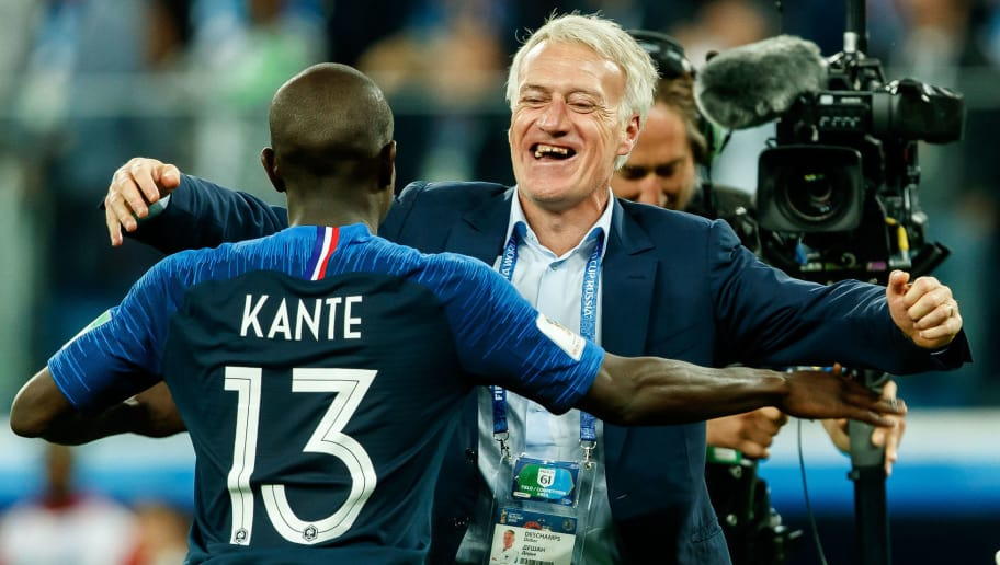 SAINT PETERSBURG, RUSSIA - JULY 10: Head coach Didier Deschamps of France and Ngolo Kante of France celebrate after winning the 2018 FIFA World Cup Russia Semi Final match between France and Belgium at Saint Petersburg Stadium on July 10, 2018 in Saint Petersburg, Russia. (Photo by TF-Images/Getty Images)