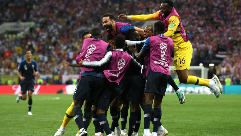 MOSCOW, RUSSIA - JULY 15:  Kylian Mbappe of France celebrates with team mates after scoring his team's fourth goal during the 2018 FIFA World Cup Final between France and Croatia at Luzhniki Stadium on July 15, 2018 in Moscow, Russia.  (Photo by Shaun Botterill/Getty Images)