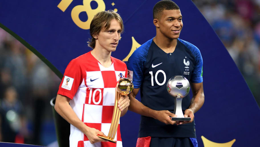 MOSCOW, RUSSIA - JULY 15:  Luka Modric of Croatia and Kylian Mbappe of France  pose respectively with their the adidas Golden Ball and with the FIFA Young Player award following the 2018 FIFA World Cup Final between France and Croatia at Luzhniki Stadium on July 15, 2018 in Moscow, Russia.  (Photo by Shaun Botterill/Getty Images)
