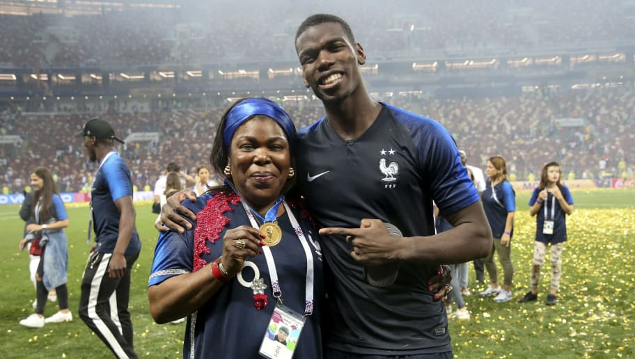 MOSCOW, RUSSIA - JULY 15: Paul Pogba of France gives his medal to his mother Yeo Pogba following the 2018 FIFA World Cup Russia Final between France and Croatia at Luzhniki Stadium on July 15, 2018 in Moscow, Russia. (Photo by Jean Catuffe/Getty Images)