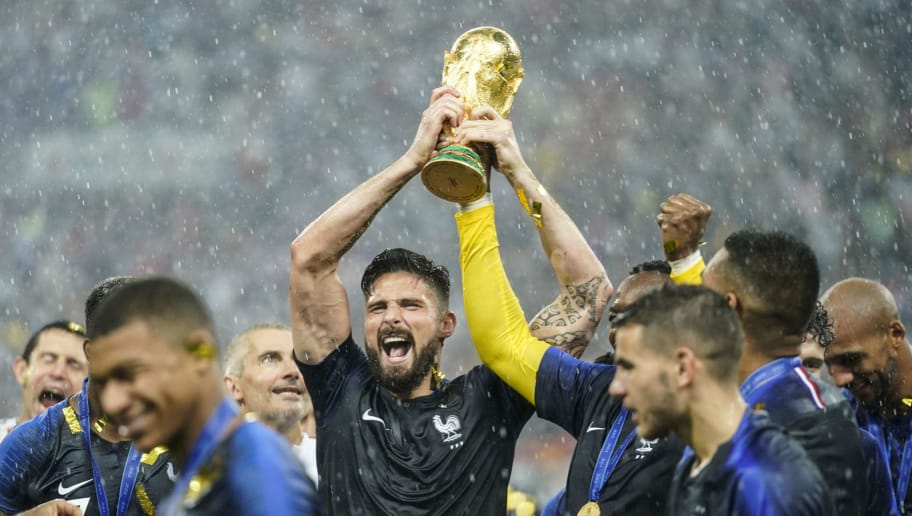 MOSCOW, RUSSIA - JULY 15:  Olivier Giroud of France celebrates with the trophy after the 2018 FIFA World Cup Russia Final between France and Croatia at Luzhniki Stadium on July 15, 2018 in Moscow, Russia.  (Photo by Fred Lee/Getty Images)