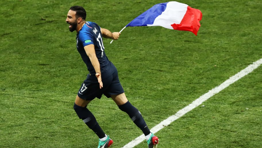 MOSCOW, RUSSIA - JULY 15:  Adil Rami of France celebrates victory, displaying the French flag, following the 2018 FIFA World Cup Final between France and Croatia at Luzhniki Stadium on July 15, 2018 in Moscow, Russia.  (Photo by Ryan Pierse/Getty Images)