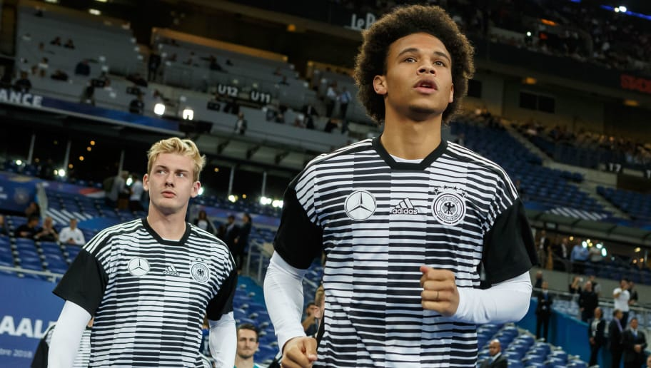 PARIS, FRANCE - OCTOBER 16: Julian Brandt of Germany and Leroy Sane of Germany look on prior the UEFA Nations League A group one match between France and Germany at Stade de France on October 16, 2018 in Paris, France. (Photo by TF-Images/Getty Images)