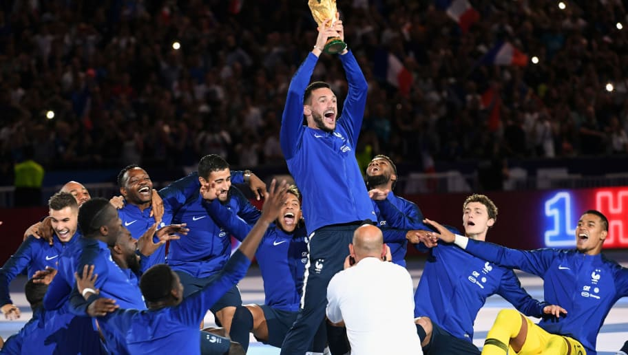 PARIS, FRANCE - SEPTEMBER 09:  Hugo Lloris  captain and goalkeeper and the France team celebrates with the World Cup Trophy after the UEFA Nations League A group official match between France and Netherlands at Stade de France on September 9, 2018 in Paris, France. This is the first match of the French football team at the Stade de France since their victory in the final of the World Cup in Russia.  (Photo by Frederic Stevens/Getty Images)