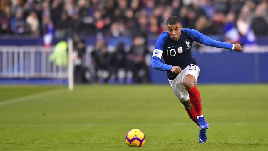 PARIS, FRANCE - NOVEMBER 20:  Kylian Mbappe of France runs with the ball during the international friendly match between France and Uruguay at Stade de France on November 20, 2018 in Paris, France.  (Photo by Aurelien Meunier/Getty Images)