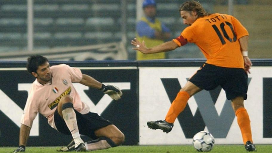 Francesco Totti takes on Gianluigi Buffon