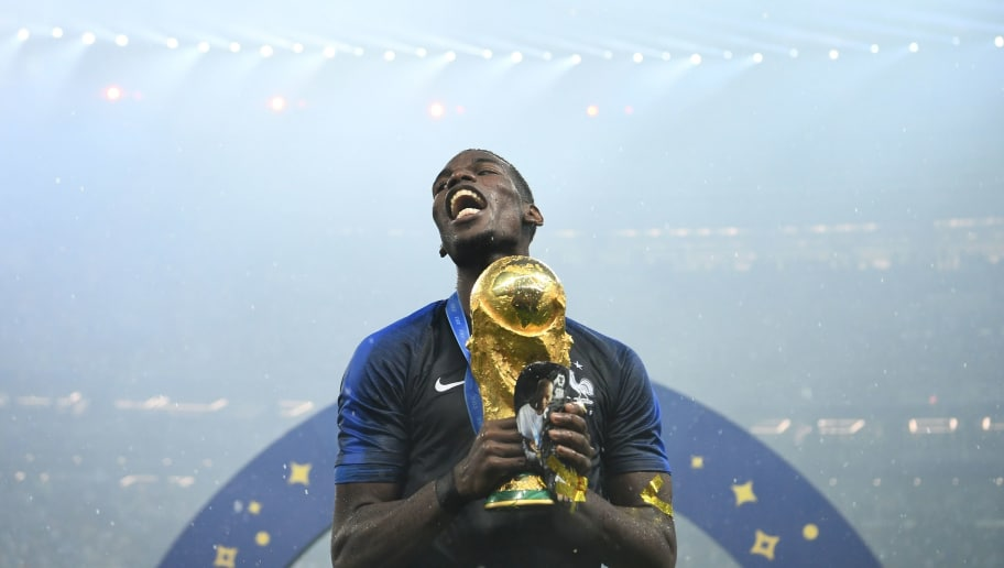 TOPSHOT - France's midfielder Paul Pogba celebrates with the World Cup trophy after the Russia 2018 World Cup final football match between France and Croatia at the Luzhniki Stadium in Moscow on July 15, 2018. (Photo by FRANCK FIFE / AFP) / RESTRICTED TO EDITORIAL USE - NO MOBILE PUSH ALERTS/DOWNLOADS        (Photo credit should read FRANCK FIFE/AFP/Getty Images)
