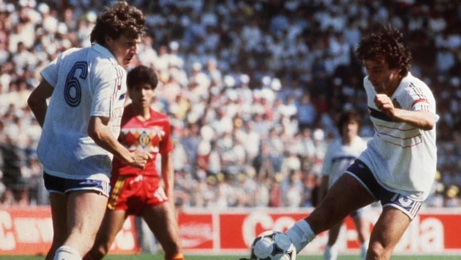 French captain and playmaker Michel Platini kicks the ball as teammate Luis Fernandez and Belgian midfielder Enzo Scifo look on 16 June 1984 in Nantes, western France, during the European Nations soccer championship match between France and Belgium. Platini scored three goals as France defeated Belgium 5-0. (Photo credit should read STAFF/AFP/Getty Images)