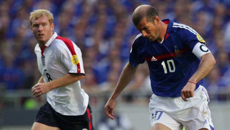 LISBON, Portugal:  French captain Zinedine Zidane (R) runs with the ball past England midfielder Paul Scholes, 13 June 2004 during their opening match at the European Nations football championships at the Estadio da Luz in Lisbon. France and England are competing in Group B with Croatia and Switzerland.  AFP PHOTO FRANCK FIFE  (Photo credit should read FRANCK FIFE/AFP/Getty Images)
