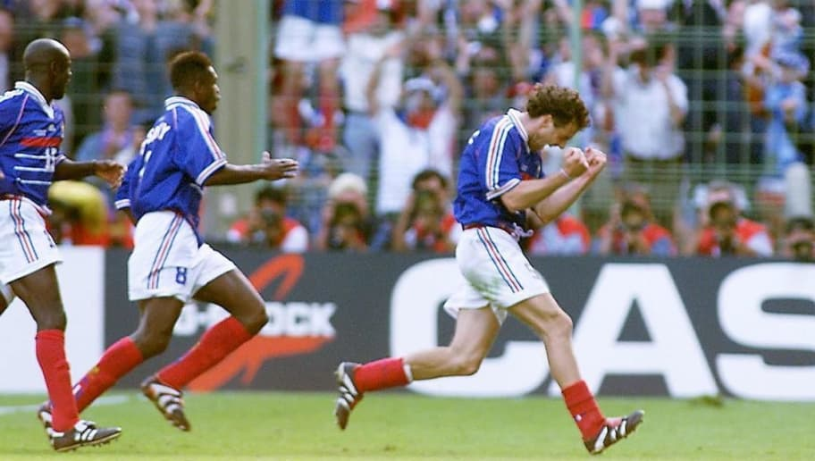 French defender Laurent Blanc (R) jubilates after scoring 28 June at the Felix Bollaert stadium in Lens, northern France, during the 1998 Soccer World Cup second round match between France and Paraguay. Blanc scored the first golden goal in World Cup history to give France a 1-0 win over Paraguay and a quarter-final showdown with Italy at Stade de France in Saint Denis 03 July.   (ELECTRONIC IMAGE)  AFP PHOTO  (Photo credit should read PASCAL GEORGE/AFP/Getty Images)