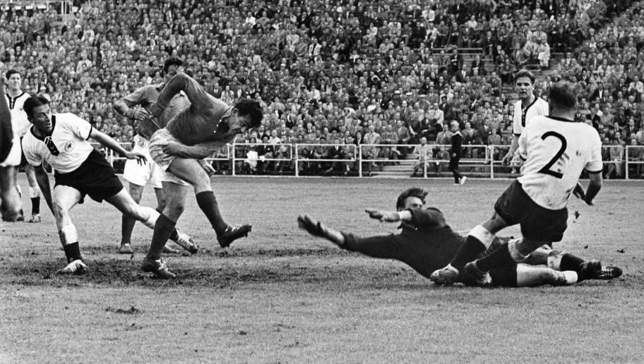 GOTEBORG, SWEDEN - JUNE 28:  French forward Just Fontaine (2nd L) scores the third goal for his team past West German goalkeeper Heiner Kwiatkowski during the World Cup soccer match for third place between France and West Germany 28 June 1958 in Goteborg. Fontaine scored four goals to help France beat West Germany 6-3. Fontaine also finished the World Cup with a record 13 goals.  (Photo credit should read STAFF/AFP/Getty Images)