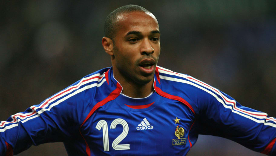 be8825bd65b French forward Thierry Henry celebrates after scoring during the friendly  football match opposing France to Greece