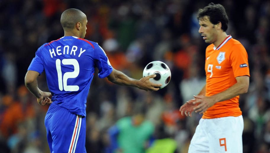 French forward Thierry Henry (L) hands t