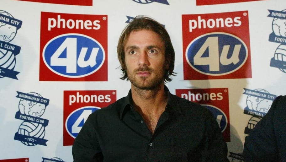 BIRMINGHAM, UNITED KINGDOM:  French international Christophe Dugarry arrives at a press conference at Birmingham Football Club 02 January 2003. Birmingham City have recruited French World Cup winner, Dugarry to their campaign to stay in the Premiership. Unveiling Dugarry at a press conference, Birmingham boss Steve Bruce said the player had signed on a loan deal from Bordeaux until the end of the season with a view to a permanent deal, provided the club stay in the Premiership.     AFP PHOTO Adrian DENNIS (Photo credit should read ADRIAN DENNIS/AFP/Getty Images)