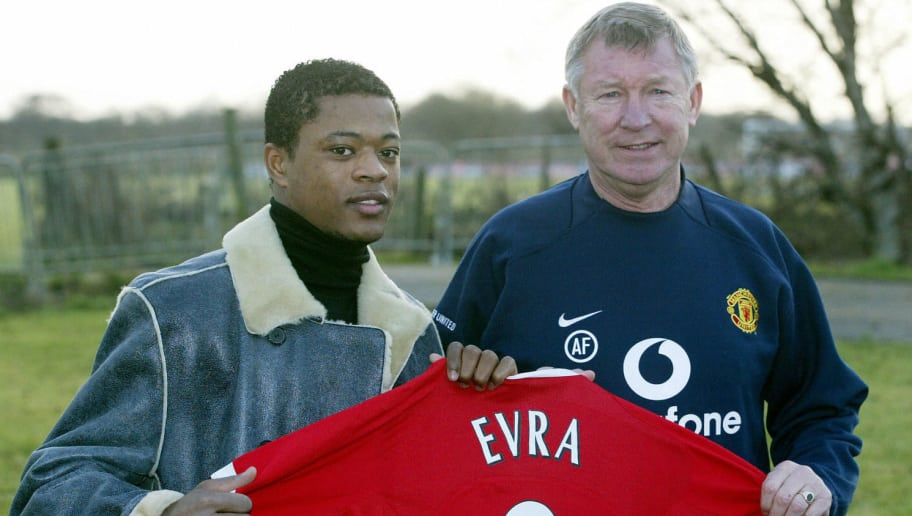 Manchester, UNITED KINGDOM:  French international defender Patrice Evra is unveiled by Manchester United manager Sir Alex Ferguson after signing for the club from Monaco, 12 January 2006 in Manchester. Ferguson has already spent 12 million pounds (21 million dollars) on defensive duo Nemanja Vidic and Patrice Evra, but is still on the look out for a replacement for skipper Roy Keane in midfield.   AFP PHOTO/PAUL ELLIS  Mobile and website use of domestic English football pictures subject to subscription of a license with Football Association Premier League (FAPL) tel : +44 207 298 1656. For newspapers where the football content of the printed and electronic versions are identical, no licence is necessary.  (Photo credit should read PAUL ELLIS/AFP/Getty Images)