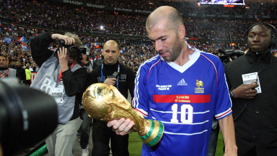French player Zinedine Zidane (C), holding the world Cup trophee, salutes the crowd after the football exhibition match between France's 1998 World Cup champions and a world selection team, on July 12, 2008, at the Stade de France in Saint-Denis, near Paris. The match gathering France's 1998 world champions and 2000 Euro winners commemorates the 10th anniversary of France's World Cup victory. The match ended in a 3-3 draw.  AFP PHOTO / PIERRE VERDY (Photo credit should read PIERRE VERDY/AFP/Getty Images)
