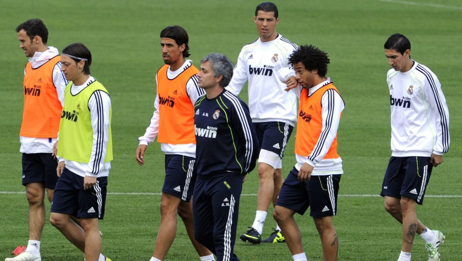 (FromL) Real Madrid's Portuguese defender Ricardo Alberto Carvalho, Real Madrid's German midfielder Mesut Ozil, Real Madrid's German midfielder Sami Khedira, Real Madrid's Portuguese coach Jose Mourinho, Real Madrid's Portuguese forward Cristiano Ronaldo, Real Madrid's Brazilian defender Marcelo and Real Madrid's Argentinian midfielder Angel di Maria attend a training session in Madrid on April19, 2011, on the eve of their Spanish Cup final match against Barcelona. AFP PHOTO / DOMINIQUE FAGET (Photo credit should read DOMINIQUE FAGET/AFP/Getty Images)