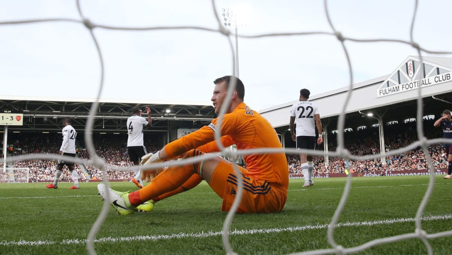 LONDON, ENGLAND - OCTOBER 07: Marcus Bettinelli of Fulham looks dejected after Pierre-Emerick Aubameyang of Arsenal's first goal during the Premier League match between Fulham FC and Arsenal FC at Craven Cottage on October 7, 2018 in London, United Kingdom.  (Photo by Catherine Ivill/Getty Images)