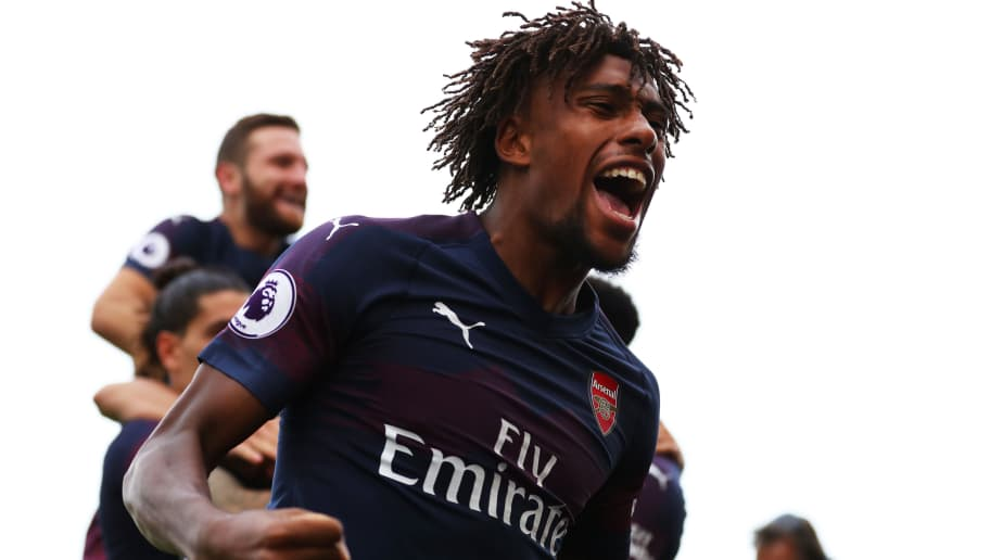 LONDON, ENGLAND - OCTOBER 07: Alex Iwobi of Arsenal celebrates after his team's second goal during the Premier League match between Fulham FC and Arsenal FC at Craven Cottage on October 7, 2018 in London, United Kingdom.  (Photo by Catherine Ivill/Getty Images)