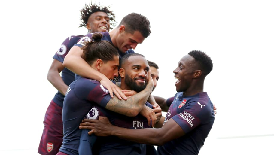LONDON, ENGLAND - OCTOBER 07: : Alexandre Lacazette of Arsenal celebrates with teammates after scoring his team's second goal during the Premier League match between Fulham FC and Arsenal FC at Craven Cottage on October 7, 2018 in London, United Kingdom. (Photo by Catherine Ivill/Getty Images)