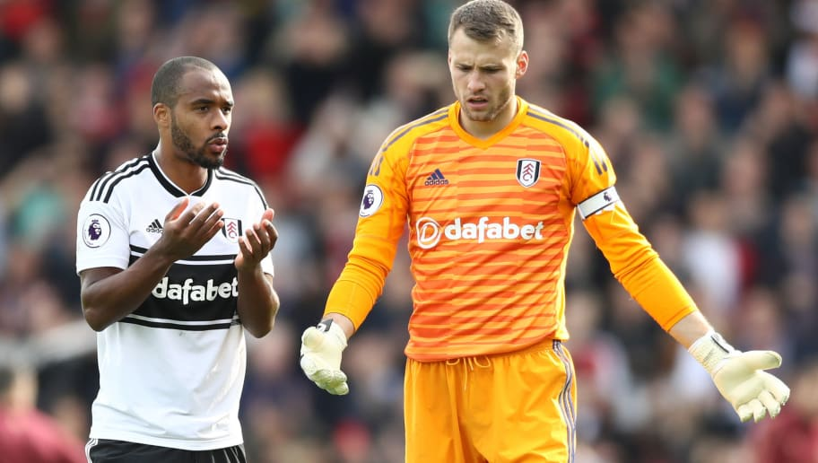 LONDON, ENGLAND - OCTOBER 07:  Denis Odoi and Marcus Bettinelli of Fulham react after the Premier League match between Fulham FC and Arsenal FC at Craven Cottage on October 7, 2018 in London, United Kingdom.  (Photo by Bryn Lennon/Getty Images)