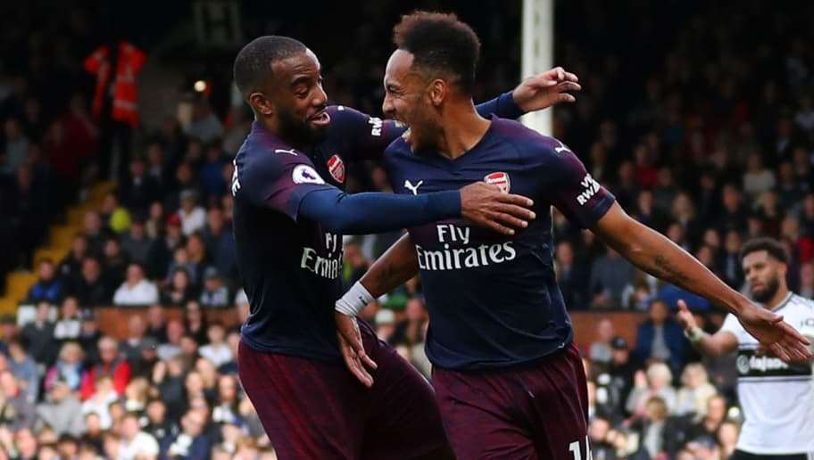 LONDON, ENGLAND - OCTOBER 07:  Pierre-Emerick Aubameyang of Arsenal celebrates with teammate Alexandre Lacazette after scoring his team's fourth goal during the Premier League match between Fulham FC and Arsenal FC at Craven Cottage on October 7, 2018 in London, United Kingdom.  (Photo by Catherine Ivill/Getty Images)