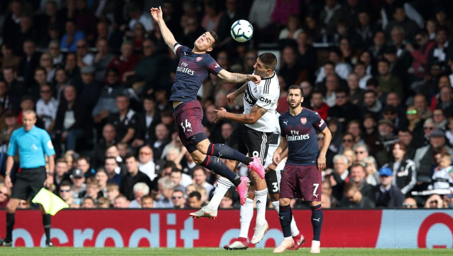 LONDON, ENGLAND - OCTOBER 07: Granit Xhaka of Arsenal and Aleksandar Mitrovic of Fulham during the Premier League match between Fulham FC and Arsenal FC at Craven Cottage on October 7, 2018 in London, United Kingdom. (Photo by James Williamson - AMA/Getty Images)
