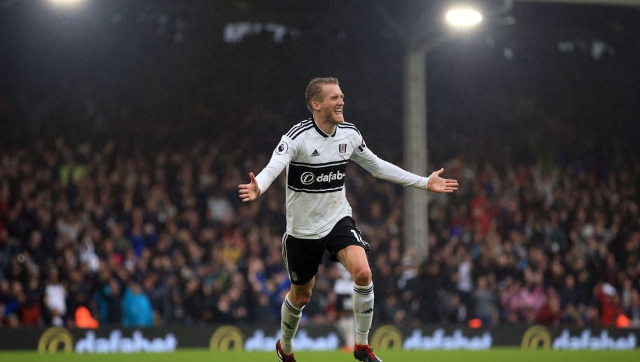 LONDON, ENGLAND - AUGUST 26: Andre Schurrle of Fulham celebrates scoring  their 4th goal during the Premier League match between Fulham FC and Burnley FC at Craven Cottage on August 25, 2018 in London, United Kingdom. (Photo by Marc Atkins/Getty Images)