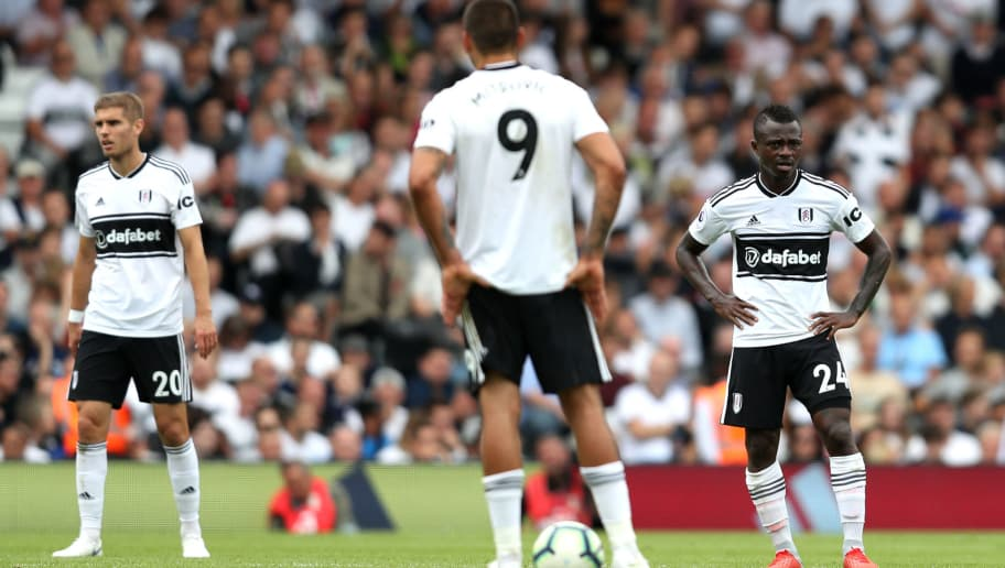 LONDON, ENGLAND - AUGUST 11:  Maxime Le Marchand, and Jean Michael Seri of Fulham look dejected after conceding during the Premier League match between Fulham FC and Crystal Palace at Craven Cottage on August 11, 2018 in London, United Kingdom.  (Photo by Christopher Lee/Getty Images)