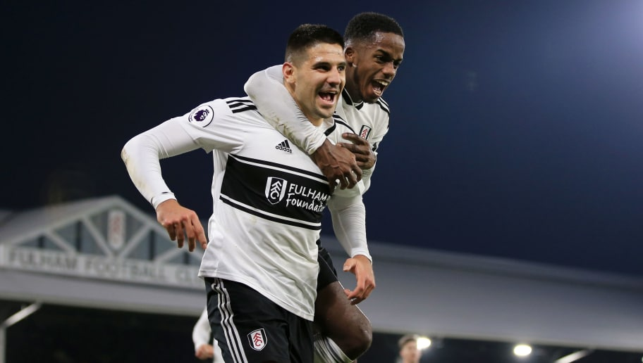 LONDON, ENGLAND - NOVEMBER 24:  Aleksandar Mitrovic of Fulham celebrates with teammate Ryan Sessegnon after scoring his team's third goal during the Premier League match between Fulham FC and Southampton FC at Craven Cottage on November 24, 2018 in London, United Kingdom.  (Photo by Marc Atkins/Getty Images)