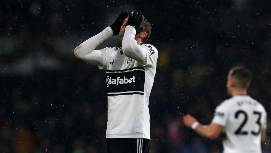 LONDON, ENGLAND - DECEMBER 15: Andre Schurrle of Fulham FC holds his head in his hands after missing a shot at goal during the Premier League match between Fulham FC and West Ham United FC at Craven Cottage on December 15, 2018 in London, United Kingdom. (Photo by Chloe Knott - Danehouse/Getty Images)