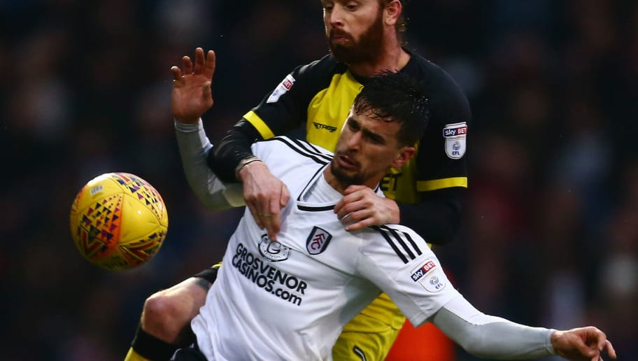 LONDON, ENGLAND - JANUARY 20:  Rui Fonte of Fulham is tackled by John Brayford of Burton during the Sky Bet Championship match between Fulham and Burton Albion at Craven Cottage on January 20, 2018 in London, England.  (Photo by Jordan Mansfield/Getty Images)