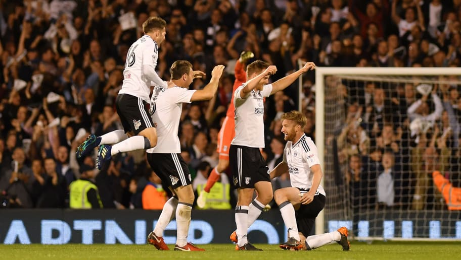 LONDON, ENGLAND - MAY 14:  Oliver Norwood of Fulham and Ryan Sessegnon of Fulham celebrates with team mates at the final whistle during the Sky Bet Championship Play Off Semi Final, second leg match between Fulham and Derby County at Craven Cottage on May 14, 2018 in London, England.  (Photo by Mike Hewitt/Getty Images)