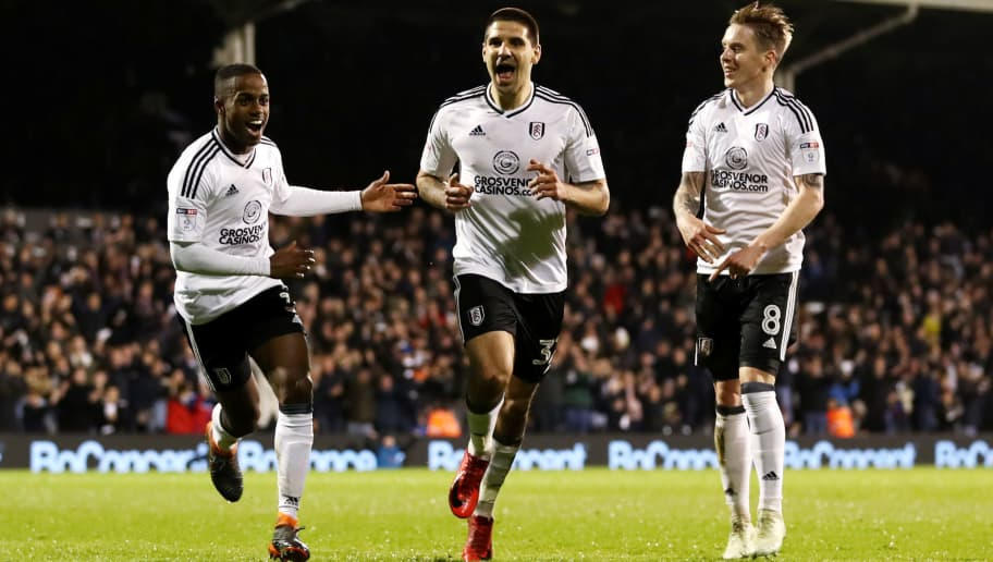 LONDON, ENGLAND - APRIL 03: Aleksandar Mitrovic of Fulham celebrates after scoring his sides second goal with his team mates during the Sky Bet Championship match between Fulham and Leeds United at Craven Cottage on April 3, 2018 in London, England.  (Photo by Catherine Ivill/Getty Images)