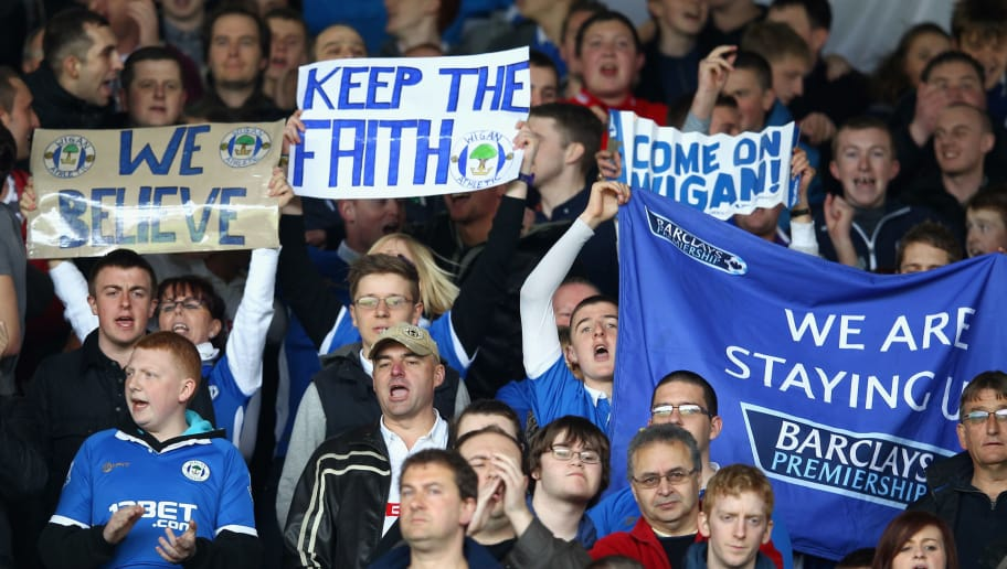 LONDON, ENGLAND - APRIL 21:  Wigan Athletic fans show their support ahead of the Barclays Premier League match between Fulham and Wigan Athletic at Craven Cottage on April 21, 2012 in London, England.  (Photo by Julian Finney/Getty Images)