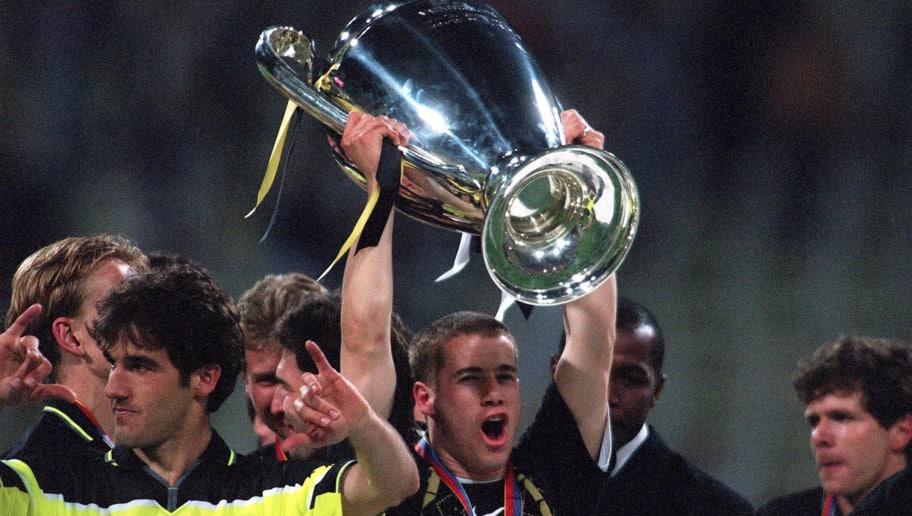 GERMANY - MAY 28:  FUSSBALL: CHAMPIONS LEAGUE TURIN - DORTMUND ,Muenchen 28.05.97, Jubel Lars RICKEN mit Pokal/DORTMUND EUROPAPOKALSIEGER  (Photo by Bongarts/Getty Images)